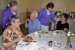 Carolyn (Kludas) Drake eats while Ora Lee (Ault) Kapp, Carolyn Bruce, Sharon (Blomquist) Moomaw, and Beatrice (Beard) Gr