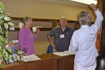 Susan Baker and Steve Singleton ready to register attendees as Ann Ray explains something--at the Elks.